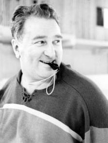 Photograph Anatoly Tarasov with a whistle in his mouth.